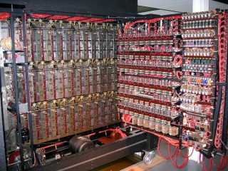 The inside of the opened bombe, showing some of the mechanical detail behind the drums to the left (with the electric motor at the bottom) and some of the electronic detail in the door to the right.