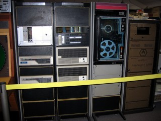 "A computer used for air traffic control. The left cabinet (""display processors"") contains two PDP-11/34s, the one to its right (""radar processors"") contains two PDP-11/84s."